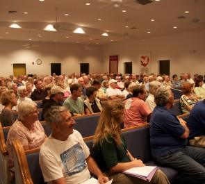 The crowd assembles for the meeting