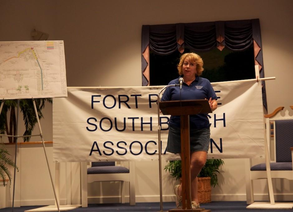 Christine Coke prepares to present the Islander Award to Mayor Bob Benton