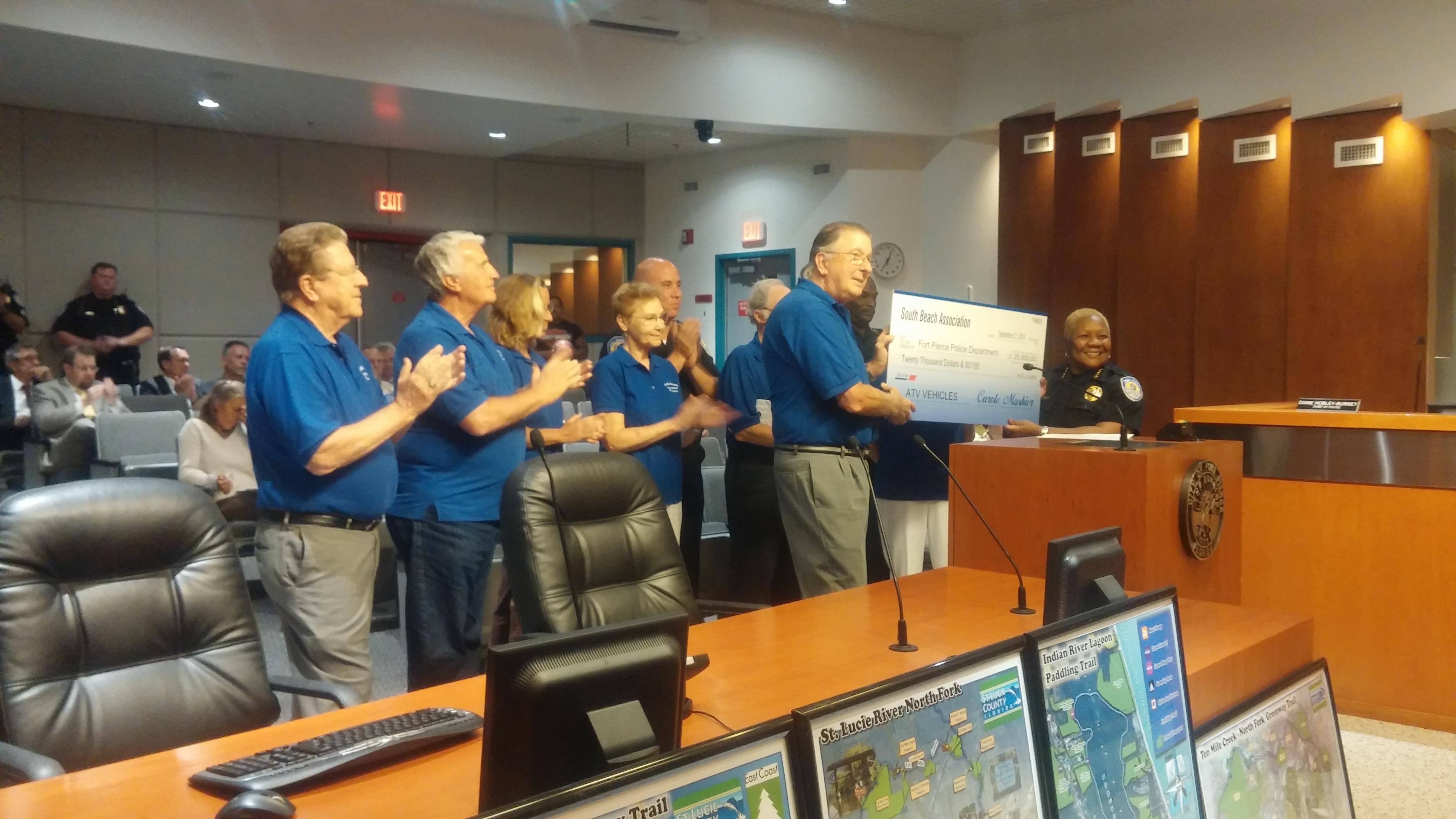 Chief Hobley-Burney receives the SBA $20,000 ATV check